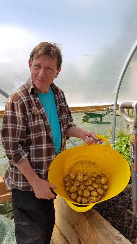 Peter with our super early tattie harvest