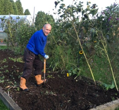 Craig clearing the flower bed
