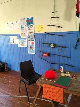 A photo of a stick christmas tree and information about carbon impact of Christmas