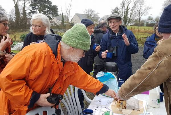 People eating cake at the Birdwatch