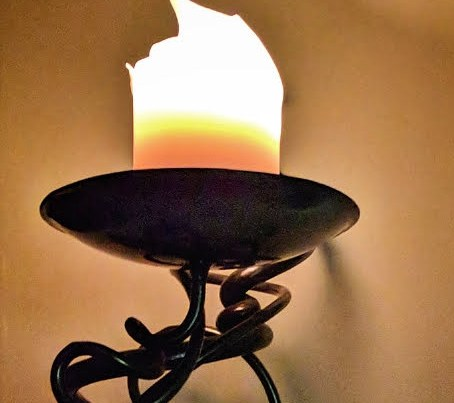 A photo of a burning candle