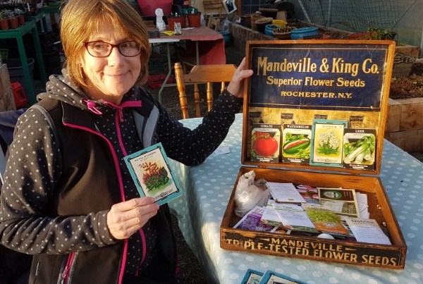 A photo of Kathleen with her seed box