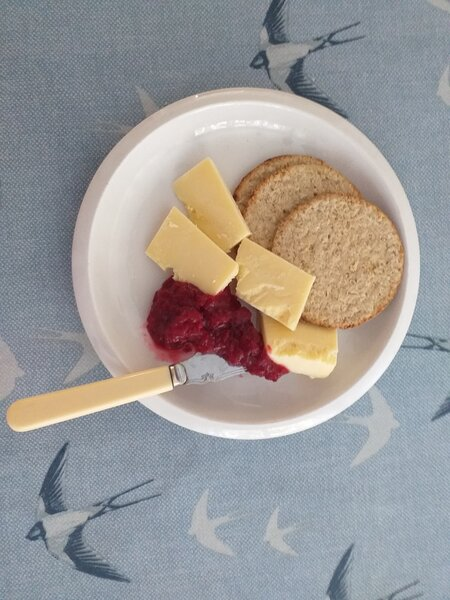 A photo of a plate with oatcakes and bramble and apple chutney