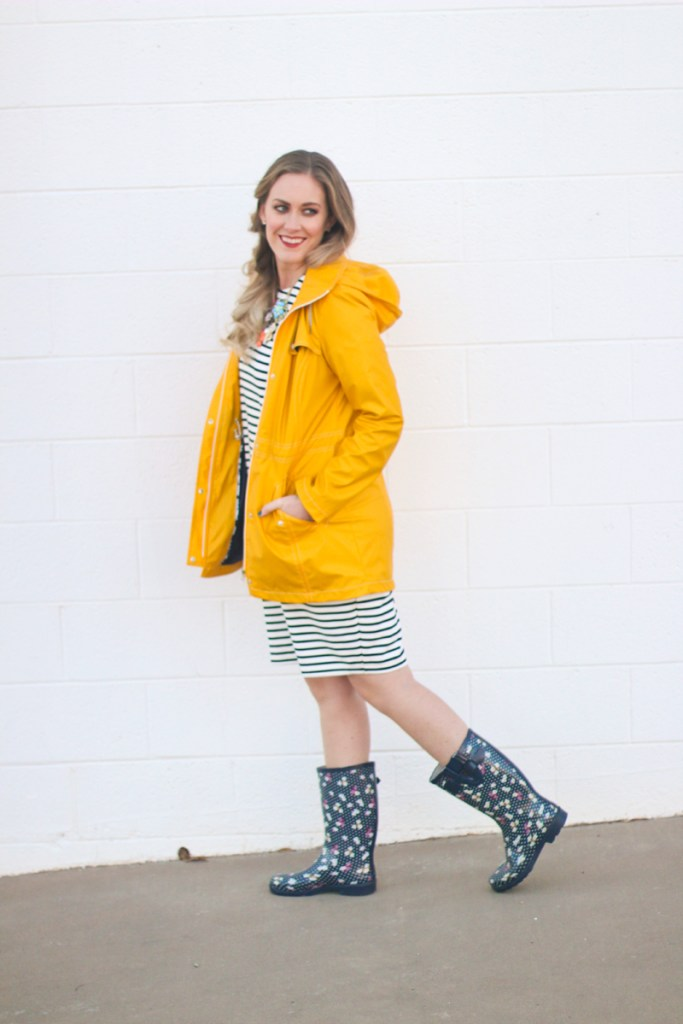 Yellow rain jacket, striped dress, rain boots