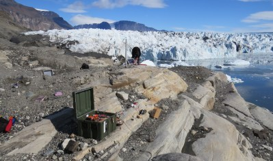 Installing a seismometer adjacent to the terminus of Rink Isbrae, a tidewater glacier in Greenland.