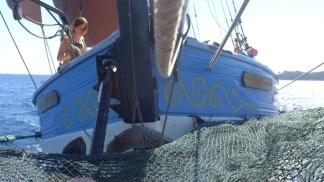 Not sure of the nautical term for the fore hammock, but it's below the super-boom/jib thingy. Fun to lie there as we sail along...