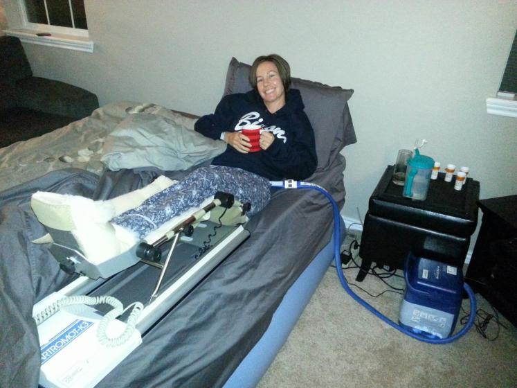 Bed set up in the living room and continuous passive motion machine after hip surgery Fall 2012.