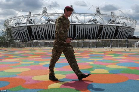 A soldier walks through the Olympic Park in Stratford yesterday as it emerged the Government is to call upon an extra 3,500 military personnel to protect the Games
