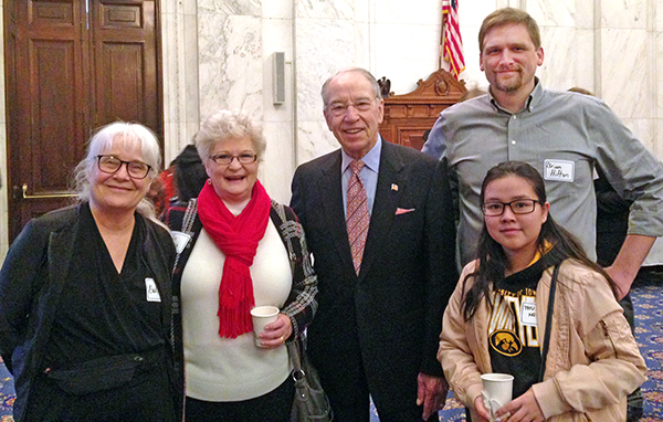 Students and faculty with Iowa Senator Charles Grassley, center.