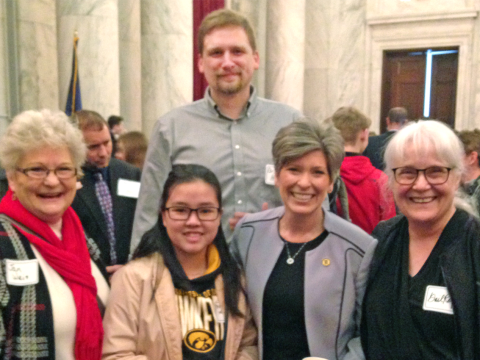 Students and faculty with Iowa Senator Joni Ernst, second from right.
