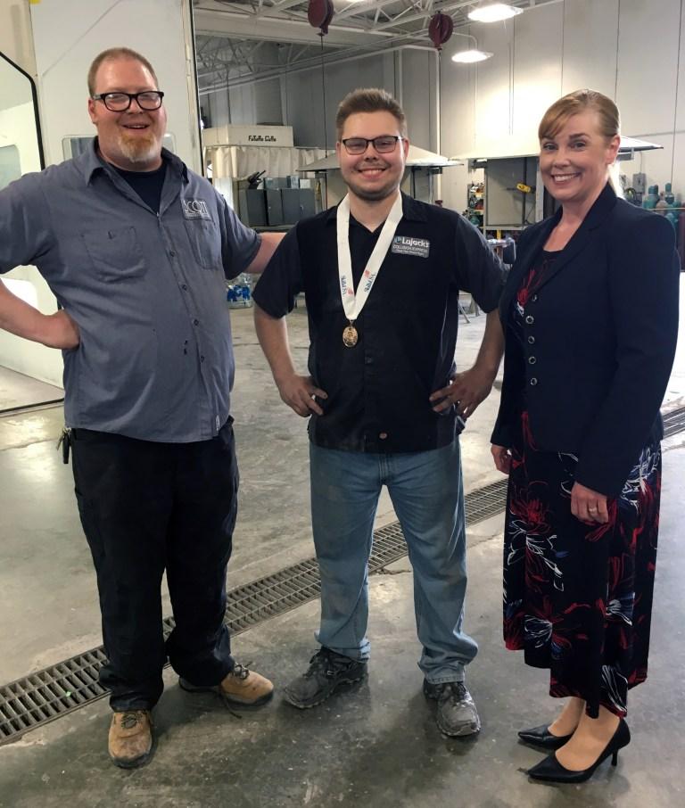 Instructor Ed Valle, standing with SKILLS USA Winner Matthew Speidel and SCC President Lyn Cochran