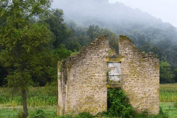 Geoffrey Mikol Photograph of old stone building titled Embraced by Fog