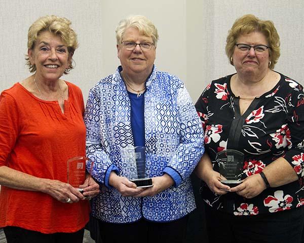 Glo Hanne, Pam Bass, and Jane Marlowe holding their Emeritus Awards