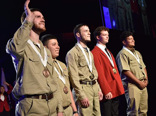 Brennan Kearney Accepting Gold Medal at SKILLS USA