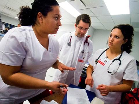 3 SCC Nursing students going over paperwork