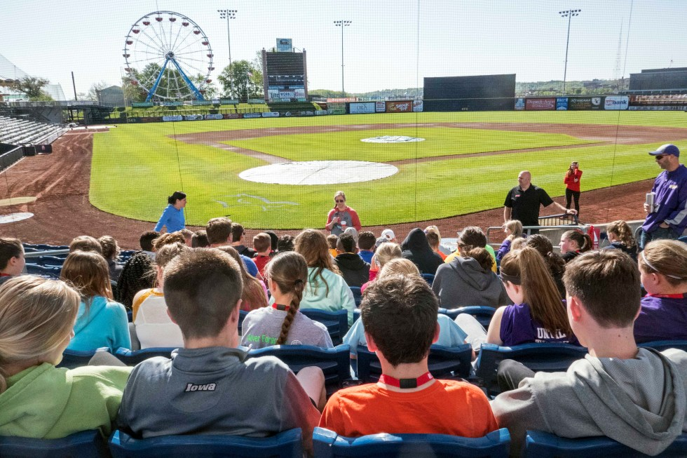 Stem at the Ballpark event, students sitting in stands facing the ball diamond