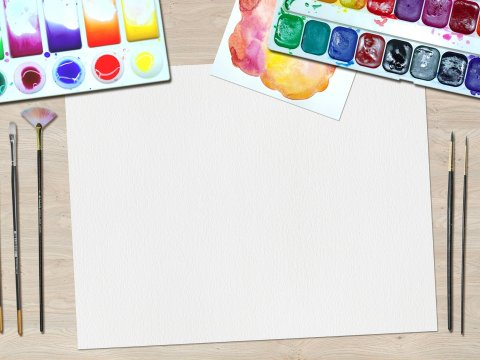 Blank white paper and paint with brushes