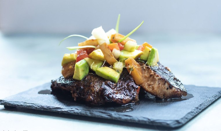 This grilled pineapple avocado salad is packed with wonderful flavors that will awaken your senses.   tchakayiti.com