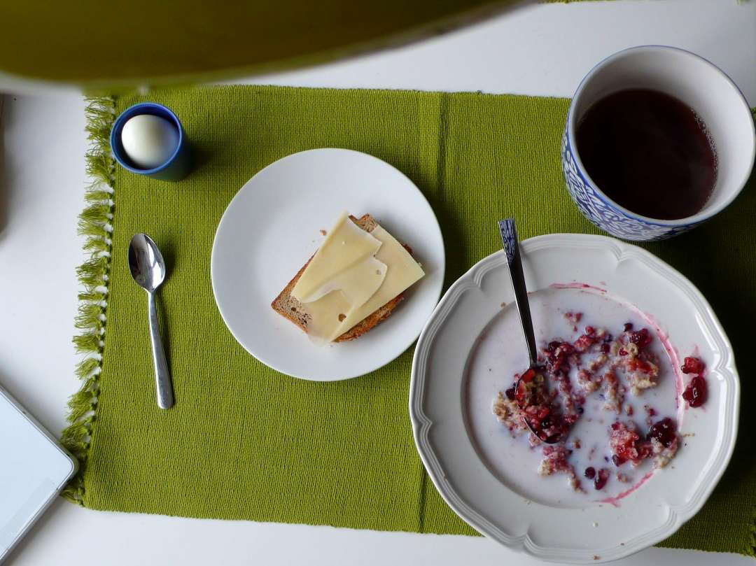 Photo of a placemat with some food and a cup of tea