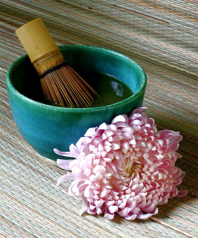 matcha tea bowl with wisk and chrysanthemum