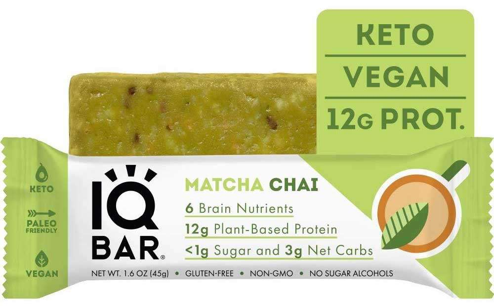 Photo of an IQBar Brain + Body Protein Bar in Matcha Chai Flavor outside of the wrapper behind an individually-wrapped bar.
