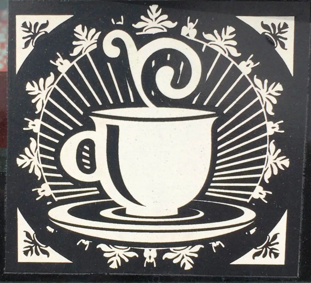 Photo of a sticker of a black and white teacup illustration.