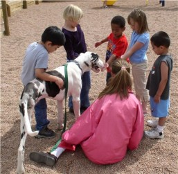 Therapy dog Stella visiting with foster children