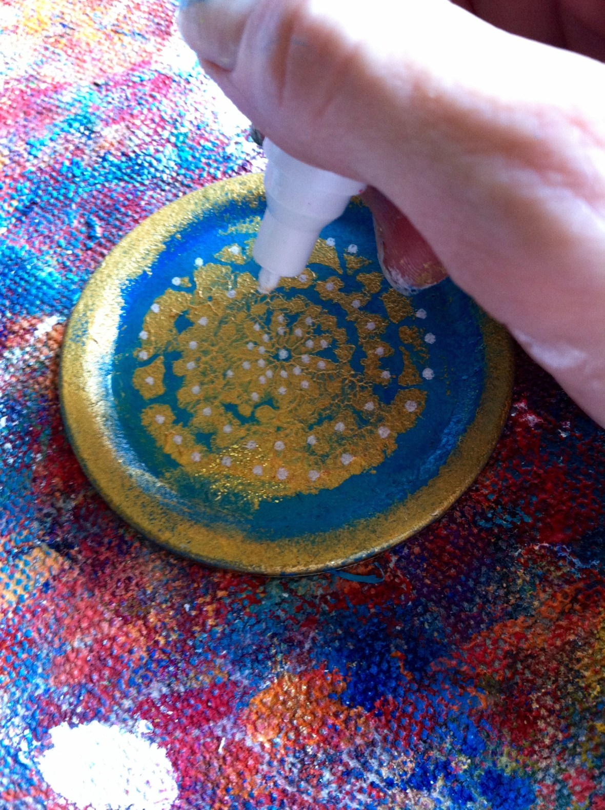 adding detail with paint pen to lid