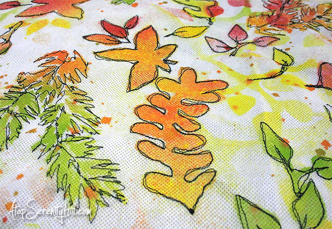 Fall Leaves Pillow Cover featuring stencils from The Crafter's Workshop, Oly-Fun multi-purpose craft material and free motion stitching! • AtopSerenityHill.com #falldecor #stenciling #freemotion
