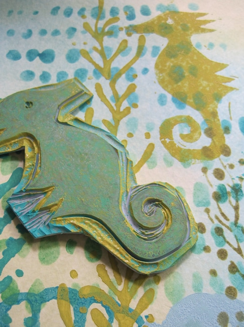 Hand-carved seahorse stamp swims in a seaweed jungle created with TCW stencil