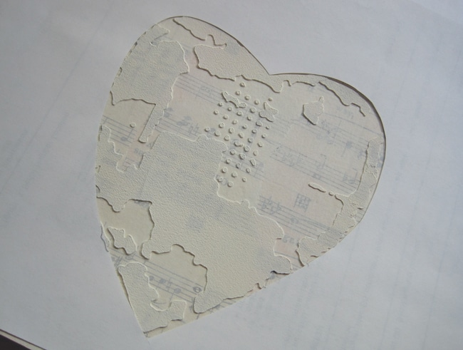 Mask out background leaving only stenciled heart exposed LEFKO