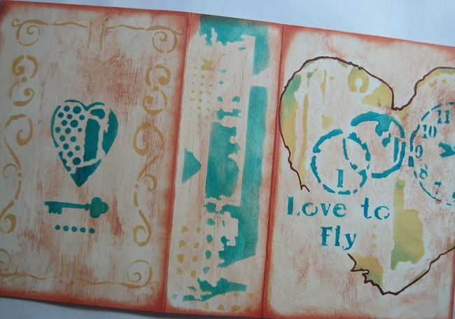Stenciled art journal cover using TCW stencils and fluid chalk inks Nancy Lefko