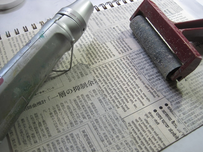 Use heat gun and brayer to smooth out wrinkles on newspaper LEFKO