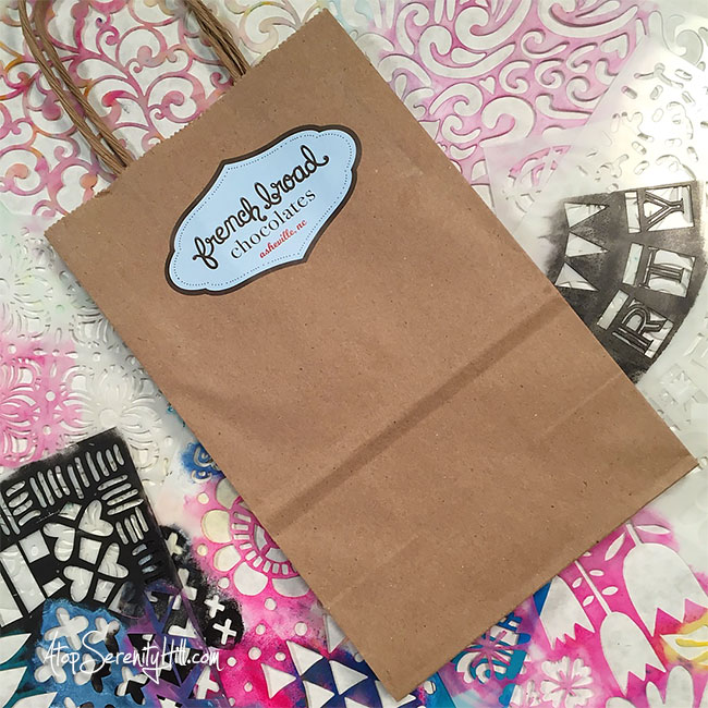 Recycle a plain gift bag with paint and stencils from The Crafter's Workshop! AtopSerenityHill.com