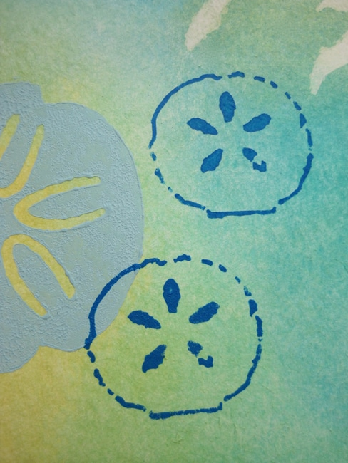 Stamped and stenciled sand dollars LEFKO