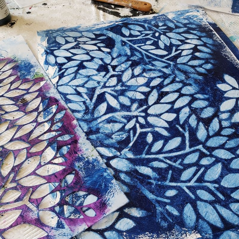 Using a baby wipe I removed the paint through the stencil to the design in blue and white.