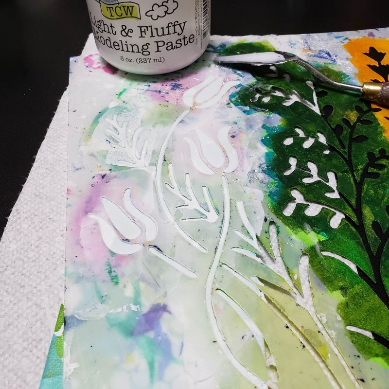 Adding Wildflower stencil to the canvas with Light & Fluffy Modeling Paste