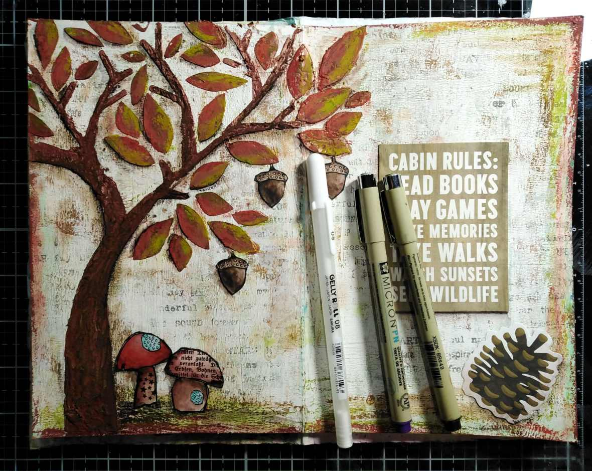 Art journal spread, adding text ephemera, diecut, highlights and shadows with Sakura pigma micron and jelly roll pens