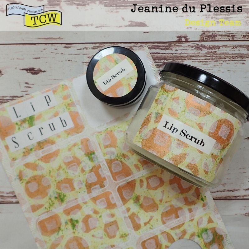 Photo of the label stickers already made, added to some jars. Colors of yellow, green, bronze and white with stenciling patterns.