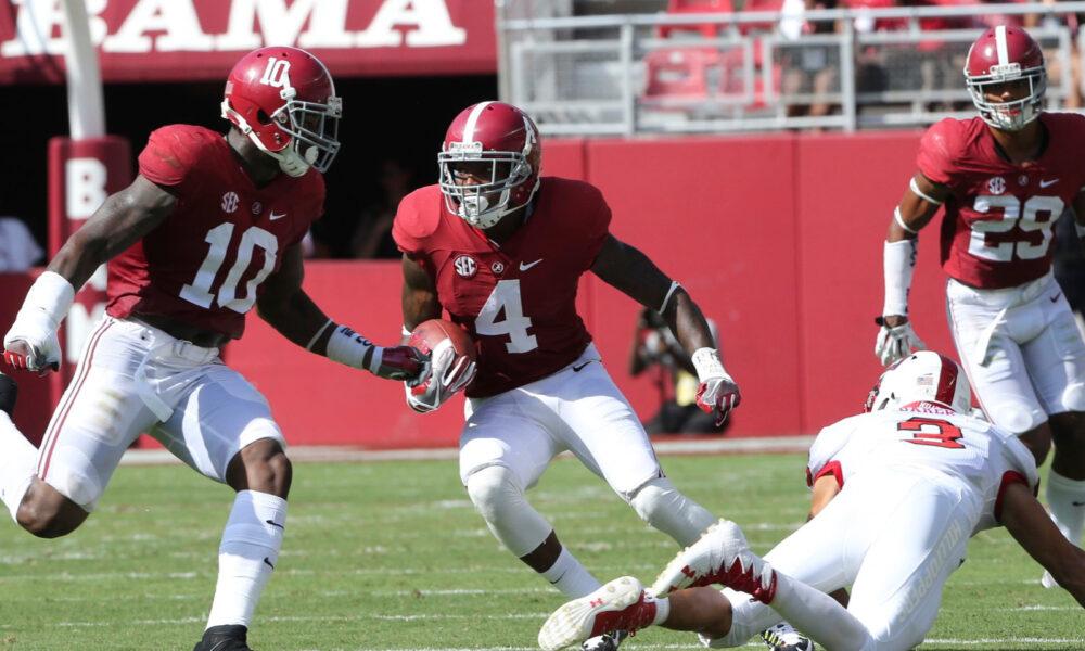 Eddie Jackson (No. 4) returns an interception for a touchdown for Alabama in 2016 versus Western Kentucky