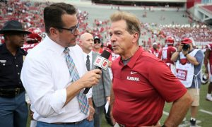 Alabama HC Nick Saban talking to ESPN's Tom Luginbill after a game in 2018