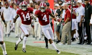 Saivion Smith (No. 4) returns an interception for a touchdown in 2018 for Alabama versus Arkansas State University