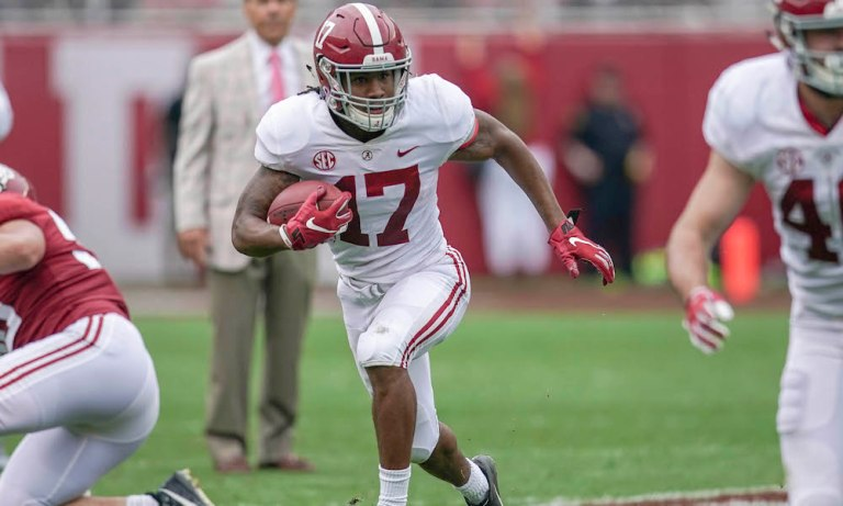 Former Alabama WR Jaylen Waddle signs his four-year, fully guaranteed contract with Miami Dolphins