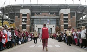 Fans outside Bryant-Denny Stadium waiting for Alabama football players during 2020 season