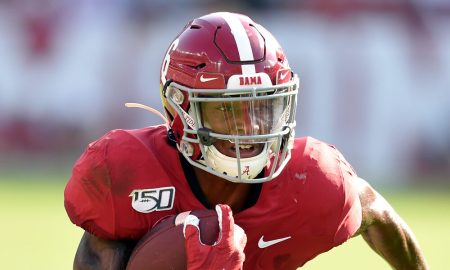 DeVonta Smith runs with the ball versus Ole Miss in 2019