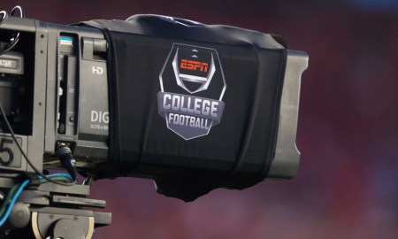 A look at ESPN's College Football logo on a camera during a 2018 matchup between Wisconsin and Western Kentucky