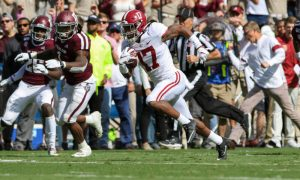 Jaylen Waddle (No. 17) runs for a touchdown in Alabama's 2019 game versus Texas A&M