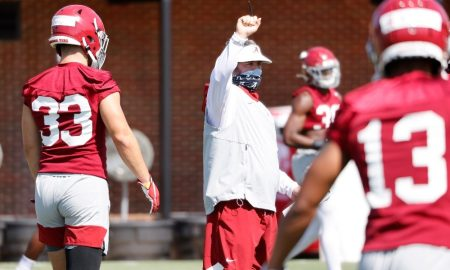 Pete Golding signals in a play at practice