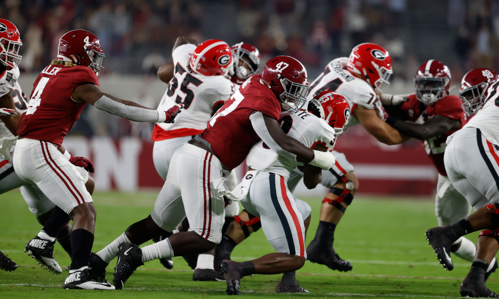 Byron Young (No. 47) records big tackle of Georgia RB Zamir White