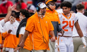 Jeremy Pruitt on the sideline coaching Tennessee against Georgia